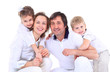Beautiful happy family - isolated over a white