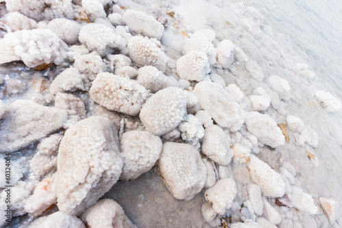 Rocks with salt on the Dead Sea shore, Jordan