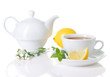 White teacup, teapot with herbal tea