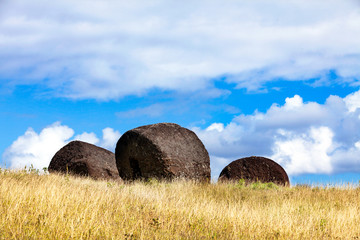 Three moai hats on field in Easter Island