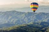 Fototapeta Hot air balloon over the mountain