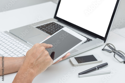Man hand working on tablet with computer background. Technology.