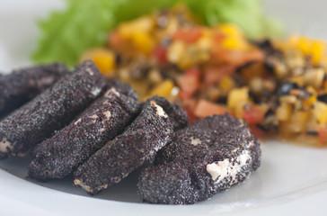 Pork Tenderloin in Poppy Seeds with olive salsa