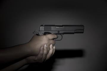 Hand holding gun preparing to fire