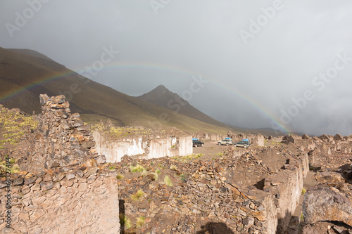 Abandoned village San Antonio de Lipez with rainbow, Bolivia