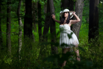 Young and attractive girl in the forest