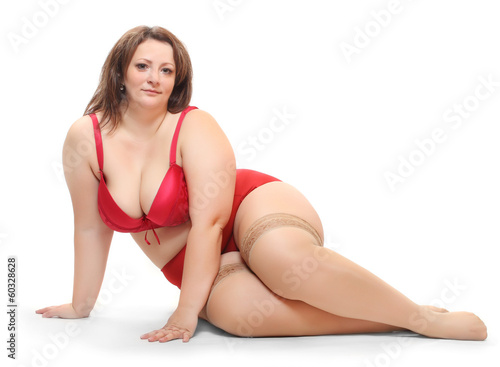 Overweight woman dressed in underwear with nylons.