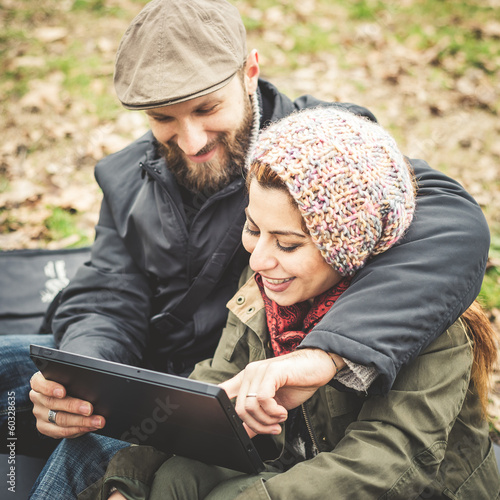 couple in love using tablet connecting web wireless wifi