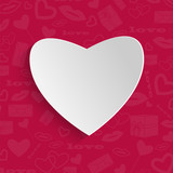background for Valentine's Day.white paper heart on a red backgr