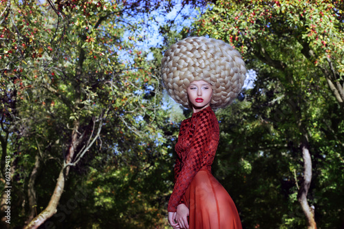 Fashion Style. Eccentric Woman in Art Wig with Braids
