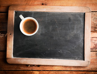 Cup of coffee on a school slate