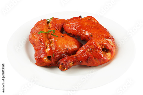 tandoori chicken legs in plate