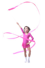Adorable little gymnast dancing with ribbon