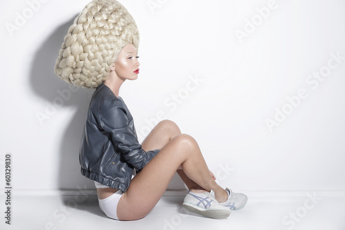 Fantasy. Woman in Unusual Wig with False Braided Hair