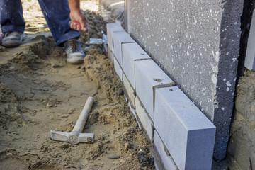 builder worker installing insulation layer