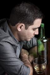 Grunge image of a drunk sad hispanic man