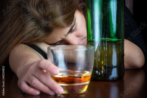 Drak image of a drunk woman suffering a hangover