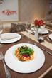 Warm appetizer made of shrimps and vegetables