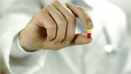 Close Up of Doctor Fingers Holding Pill Capsule