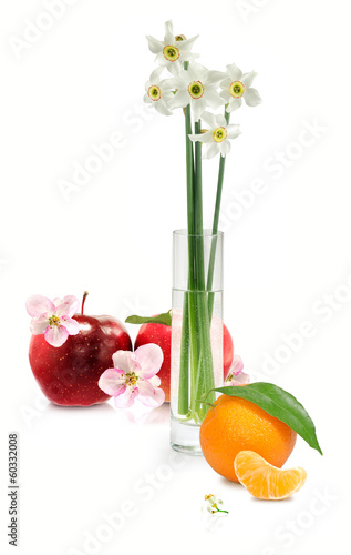flowers in a vase, apple and orange on a white background