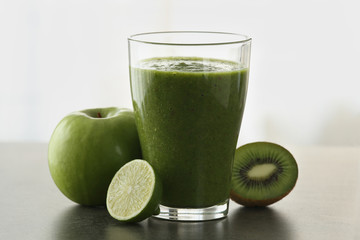 Green healthy smoothie with lime kiwifruit and apple