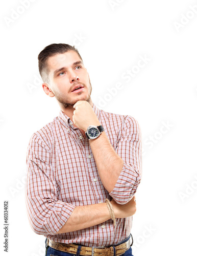 Thinking man isolated on white. businessman looking up