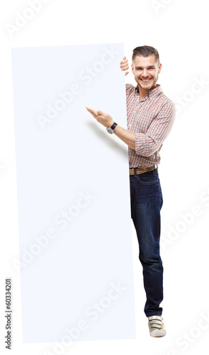Happy business man presenting your text isolated on white