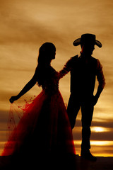 silhouette cowboy and woman in dress