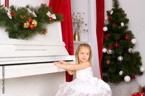 girl playing on white piano