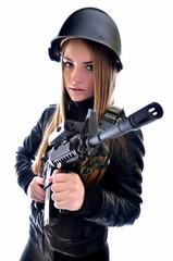 Beautiful sexy woman posing with a gun