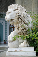 Lion statue with his paw on a sphere