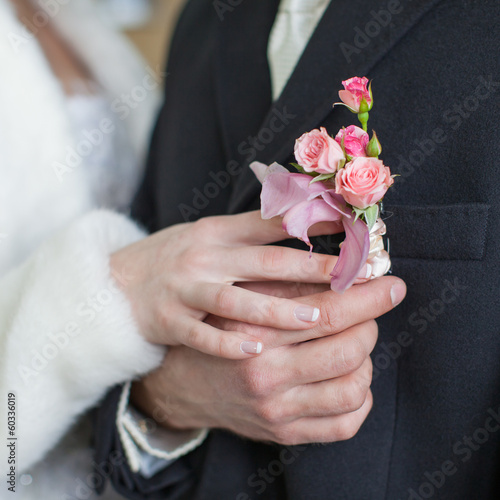 Hands of newly wedded before wedding ceremony