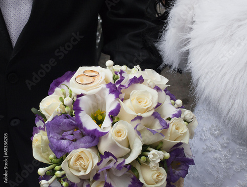 Wedding rings on a bridal bouquet