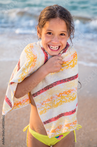 Smiling girl frozen on the beach