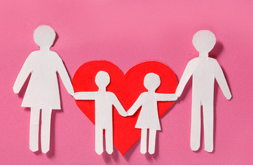 Paper Family and Red Heart over pink background. Love, Kids