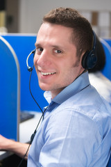call center operator with headset smiling