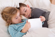 Cute little girl and boy reading a bedtime story