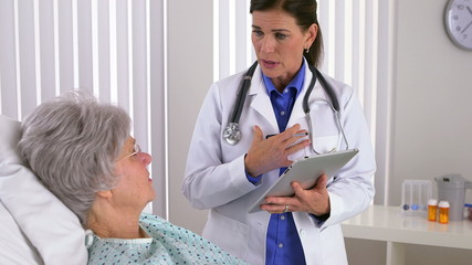Woman doctor taking notes on tablet