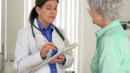 Senior doctor talking about positive test results to patient