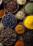 Assortment of spices in wooden bowl background