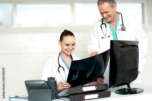 Physicians reviewing patients x-ray report