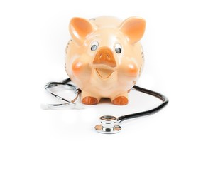 stethoscope in front of piggy bank, concept for save money