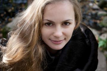 Woman with Long Hair in Black Fur Coat