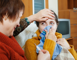 Mature woman caring for her adult daughter has cold