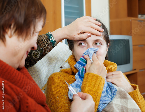 Poster Mature woman caring for her adult daughter has cold