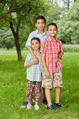 Portrait of three boys-brothers who stand together