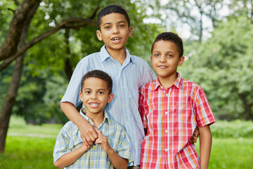 Half-length portrait of three boys-brothers who stand together