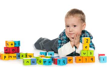 Preschool little boy with blocks