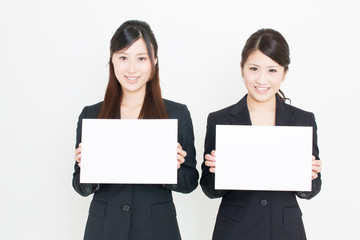 young asian businesswomen with whiteboard
