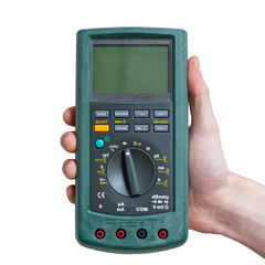 Digital multimeter in technicians hand